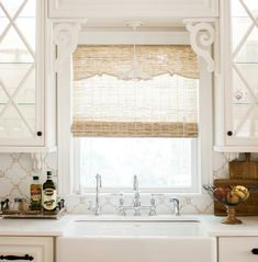"""I like the natural colored bamboo blind for the kitchen-plenty of soft filtered light and """"affordable""""."""