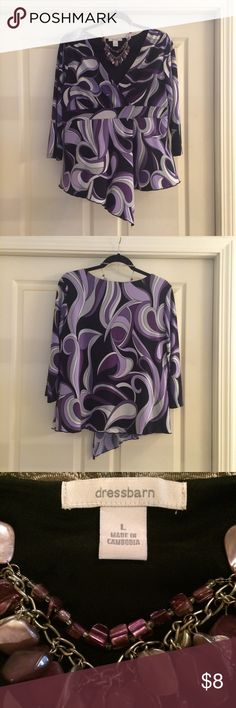 💜Purple Geo Dressbarn Blouse💜 So who doesn't like to go a little bold & geo from time to time?!  This fun top has the color, boldness & design to take you there!  V-neck, empire waist, 3/4 sleeve & handkerchief hem all make this a wonderful blouse to add the your wardrobe.  Size L.  Polyester/spandex blend.  Machine washable.  Smoke free home. Dress Barn Tops Blouses