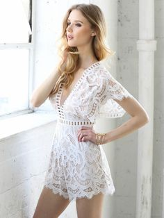 df750eae9ce4 White and nude lace romper with sleeves and cutout details. Sexy summer  outfit for the beach