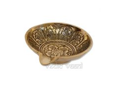 Flower Carved Brass Diya, Buy online Lamp Diyas Vedicvaani.com. Buy puja lamps in India best price at Diwali festival decoration, find Ethnic Brass Handicrafts. Flower Carved Brass Diya is an artistic decorative handmade brass lamp curved in elegant traditional design.   The lighting of 'diya' or lamp at home is considered highly auspiciousness as it brings prosperity and good health.