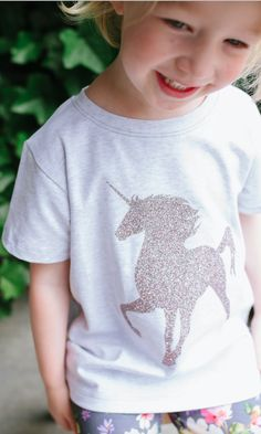 Psst. Have you heard? We're doing a limited run of our Glitter Unicorn Graphic just in time for summer. Get them on our Heather Grey Tee and make some magic happen this season.