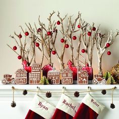 MantleScape - Love the tree branches with red ball ornaments!