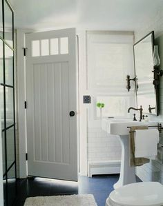 Love this idea for letting some light into a bathroom without any windows (door transom).