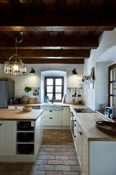 This is just like what renovations of old Santa Fe, NM houses look like...brick floors, thick walls, wood ceilings and beams. Rustic and elegant too.