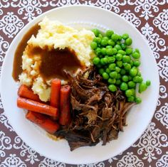 Slow Cooker Red Wine Pot Roast | Try this recipe for your next dinner party!