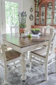 Farmhouse table with light grey base and distressed dark grey top