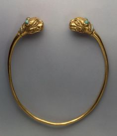 Torque (Grivna) with Terminals in the Shape of aTiger. Epoch. Period: Early Iron Age. Date: Sakae Culture. 4th century BC. Place of finding: Siberian collection of Peter I. Archaeological site: Russia, Siberia. Material: gold and turquoise. | © 1998 - 2015 The State Hermitage Museum.