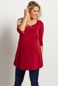 We love this simple, basic sash tie maternity top! This top will be your new go-to piece for all your casual occasions this year. Easily pair this top with your favorite maternity jeans, boots, and a long delicate necklace for a totally chic ensemble.