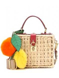 Dolce & Gabbana - Dolce embellished bamboo shoulder bag - Incorporating the brand's Sicilian heritage into the design, the wicker bag is adorned with bright lemon and orange charms. Picnics in the park have never been chicer - @ www.mytheresa.com