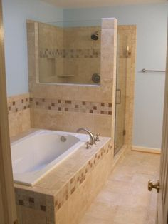 Transitional Bathroom with ceramic tile tub and shower surround