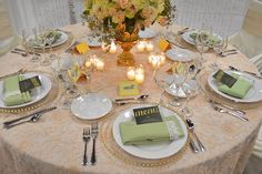 The 'Blushing with Romance' Tablescape featured our blush floral overlay on blush matte satin linen; Ivory matte satin bag style chair cover with champagne sash tie; Gold beaded glass charger with celadon linen napkin; Gold bellagio urn makes up part of the centerpiece. Popular pink/blush wedding decorations! #dressyourday #weddingfairmn festivitiesMN.com