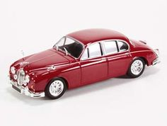 This Jaguar MkII Diecast Model Car is Burgundy and features working wheels. It is made by Ex Mag and is scale (approx. Comes in acrylic display case with photo background. Jaguar Models, Acrylic Display Case, Diecast Model Cars, Scale Models, Cars And Motorcycles, Wheels, Burgundy, History, Vehicles