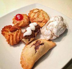 Varie specialità dolciarie di Sicilia: mpanatigghi, fiocchi di neve, paste di mandorla.....