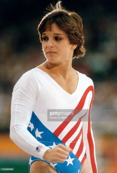Gymnast Mary Lou Retton of the United States looks on during gymnastics competition during the Games of the XXIII Olympiad in the 1984 Summer Olympics circa 1984 at UCLA's Pauley Pavilion in Los Angeles, California.