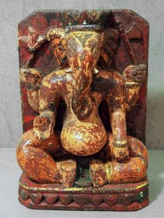Lovely painted Ganesh with a happy fat belly. http://bringingitallbackhome.co.uk/shop/painted-wooden-ganesh-statue/