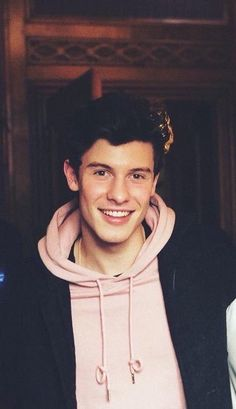 Shawn looks very cute in pink