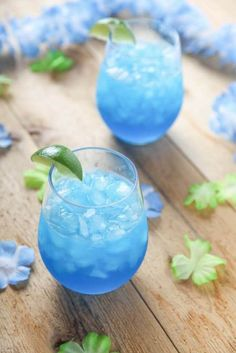 These Blue Margaritas are easy to make and they are so delicious too! You only need 4 ingredients to make them -- and no blender or cocktail shaker!