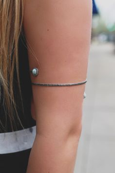 Put a twist on your usual bracelet stack with our American Hippie Arm Cuff! It is an etched, burnished silver, spiral arm cuff featuring faux turquoise stones.