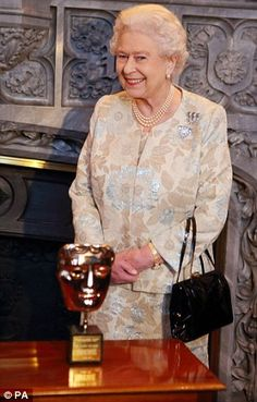 Delighted: Queen Elizabeth received an honorary Bafta in 2013 in recognition of a lifetime's support of British film and television.