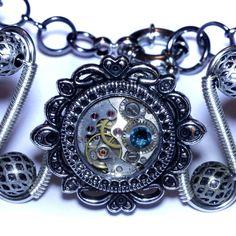 Steampunk Jewelry - Silver Tone - Bracelet with antique watch movement and Dark Aqua swarovski crsytal: https://www.etsy.com/ca/listing/157886292/steampunk-jewelry-silver-tone-bracelet