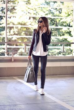 White button-up blouse, gray skinny jeans, white high-top Converse sneakers, black leather moto jacket