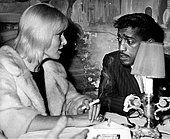 Sammy Davis Jr. talking with his wife May Britt - Stock Photo