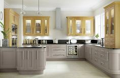 Cooke & Lewis Carisbrooke Taupe Framed | DIY at B&Q. Not sure on toop units but Note black worktop with these base units. Light floor looks good too