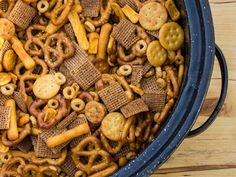 Make Bits and Bites mix at home with this simple recipe. Shreddies, Cheerios, Cheese Bits, Ritz, Pretzels, Chex and mixed with butter, worchestershire, tabasco