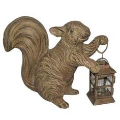 Crafted of metal. Product: Lantern Construction Material: Metal Color: Stone Dimensions: H x W x D Note: Candle not included Secret Squirrel, Cute Squirrel, Squirrels, Votive Candle Holders, Votive Candles, Garden Lanterns, W 6, Joss And Main