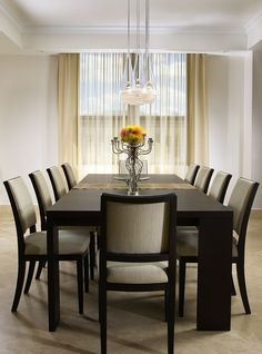 Luxurious comfortable dining chairs with plain upholstery, dark timber matches lounge suite legs, modern but classic