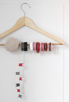 What a cute way to organise craft material! Use cloth hanger to hang ribbons and threads..makes cute decoration of the wall space