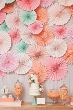 A cluster of pretty paper pinwheels makes a gorgeous backdrop for any celebration - a wedding, shower, engagement party or even a rehearsal dinner!that cake is gorgeous too.idea for a styled wedding shoot Decoration Evenementielle, Party Wall Decorations, Pinwheel Decorations, Paper Wedding Decorations, Paper Fans Wedding, Tissue Paper Decorations, Umbrella Decorations, Easy Decorations, Background Decoration