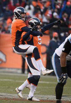 12/8/13: Broncos kicker Matt Prater (5) celebrates with Denver Broncos punter Britton Colquitt (4) his record 64 yard field goal. It was only 14 degrees outside when he kicked it. I was at that game! Only Broncos game I've been to so far. Thank goodness for handwarmers in my boots & gloves!