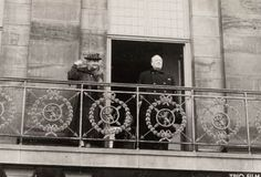 Queen Wilhelmina and Sir Winston Churchill on the balcony of the Royal Palace on the Dam. The former British Prime Minister visits the Netherlands from 8 to 13 May 1946 to celebrate the first anniversary of the liberation. In the Amsterdam Town Hall he is presented with a medal. He tours Amsterdam with members of the Royal Family by car and boat. He is cheered by 30,000 people on the Dam.