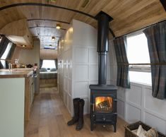 This stunning high-end renovation is also by ARC Airstreams. Called the English country retreat, it features not only quality furnishings and fittings but also leadlight windows and a fully functional fireplace. Live the Airstream Life Vicariously With a New Book That Celebrates the Timeless Trailers - Photo 11 of 20