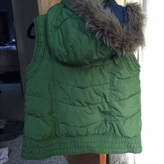 Mossimo puffy vest with fur trimmed hood Green puffy Mossimo Vest from Target. Hood zips off to allow for a hooded sweatshirt underneath. Smoke free, pet free home. No tears and no stains! Perfect for chilly spring mornings 🌷 Mossimo Supply Co Jackets & Coats Vests