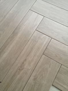 grayish flooring, herringbone pattern - laundry room possibility? Maybe not enough space for the pattern