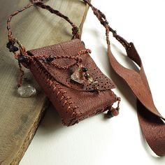 Brown Leather Pouch in shaman medicine bag style with crystals, stone and wood beads. £58.00, via Etsy.