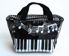 Musical Faux Leather Hand Bag Music Treasures Co. http://www.amazon.com/dp/B00BJ76NYA/ref=cm_sw_r_pi_dp_rE9gub1YK0PW3