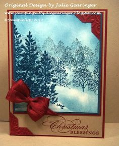 "By Julie Gearinger. Uses ""Lovely as a Tree"" stamp set by Stampin' Up. Tear a piece of scrap paper for the horizon mask. Sponge with Not Quite Navy Classic Ink to apply the layers of the light to dark blue areas (mimicking fog and snow). Stamp the trees using the mask to cover some of the lower branches & trunks & stamp off before stamping the trees for the background (gradually allowing darker ink as you come forward in the scene). [More directions on her website.]"