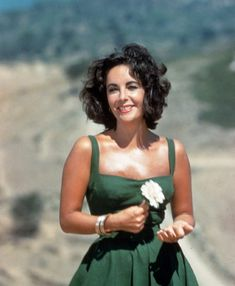 Elizabeth Taylor, bronzed and happy on the set of Suddenly Last Summer in 1959.