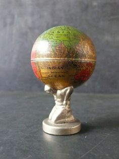 Globe Atlas Holding Up World Pencil Sharpener
