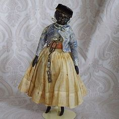 Early German Papier Mache Black Doll with Wooden Limbs from ~ LYNETTE GROSS ANTIQUE DOLLS ~ found @Doll Shops United http://www.dollshopsunited.com/stores/lynettegrossdolls/items/1302601/Early-German-Papier-Mache-Doll-Wooden-Limbs #dollshopsunited