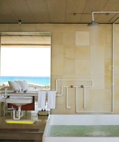 Basico, Playa del Carmen, Mexico    The Shower: Book the Patricia, Paulina, and Sofia rooms for the industrial-chic tub and shower that shares the bedroom space; floor-to-ceiling windows look out to the ocean.    The Property: Located in the heart of hip Playa, this modern beach hotel features lush plants, oil-drum swimming pools, and exposed pipes in its public spaces.
