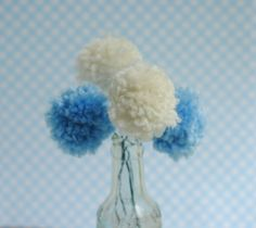 Pom Pom Flower Centerpieces - These adorable fluffy balls of yard make great DIY baby shower decorations or perfect centerpieces for nearly any party or gathering. Even better they are inexpensive and simple to make.
