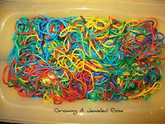 Hunting for treasure in rainbow pasta.  Messy St. Patrick's Day fun