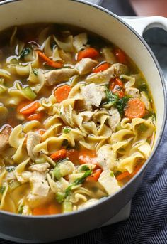 Homemade Chicken Noodle Soup is incredibly easy to make and pure comfort in a bowl. Using homemade stock makes it insanely flavorful, but I'm showing how to make it with either store-bought stock or homemade so you can have it anytime you want! #cookiesandcups #chickennoodlesoup #homemade #chickensoup #chickenstock