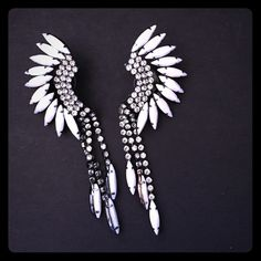 Elizabeth Cole white Mohawk earrings Beautiful and most unique Mohawk earrings. If you know of her brand, everything is quality and it shows. No scratches. Perfect condition. Worn twice. Elizabeth Cole Accessories