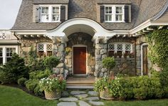 Smaller windows that are made even smaller with diamond panes keep the house from feeling too large and overwhelming.