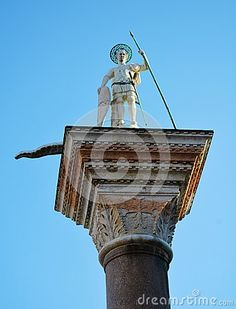Statue of St. Theodore against the blue sky in St. Mark's Square, Venice, Italy, Europe.